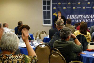 Clair Gelineau raises her hand. Photo by Jess Mears.
