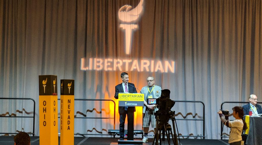 Libertarian Party of Libertarian National Committee Chair Nicholas Sarwark bestows an honorary life membership upon Libertarian Party of Michigan Founding member Dr. James Hudler, at the 2018 LNC Convention. Photo by Greg Stempfle.