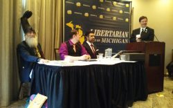 The Libertarian Party of Michigan 2019 Presidential Debate. From Left: Vermin Supreme, Chris Marks, and Arvin Vohra.