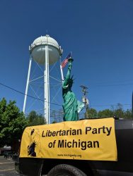 The LPOC's giant aluminum Statue of Liberty rides aboard Paul Vainer's truck at the Sylvan Lake Memorial Day Parade. Photo by Greg Stempfle.