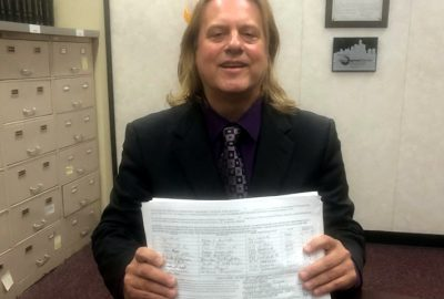Scotty Boman proudly holds up petitions from Detroit District 4 residents who want a new governing body (Community Advisory Council). Photo by Deborah Outlaw.
