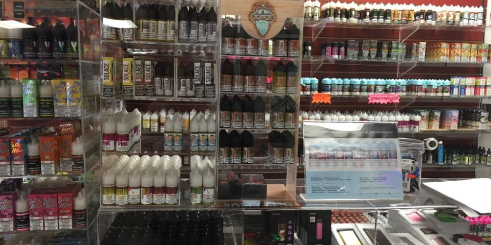 Vapers preferred flavors behind the counter at Wild Wild West Tobacco in Boyne City, MI. Photo by Robin TaChoir.