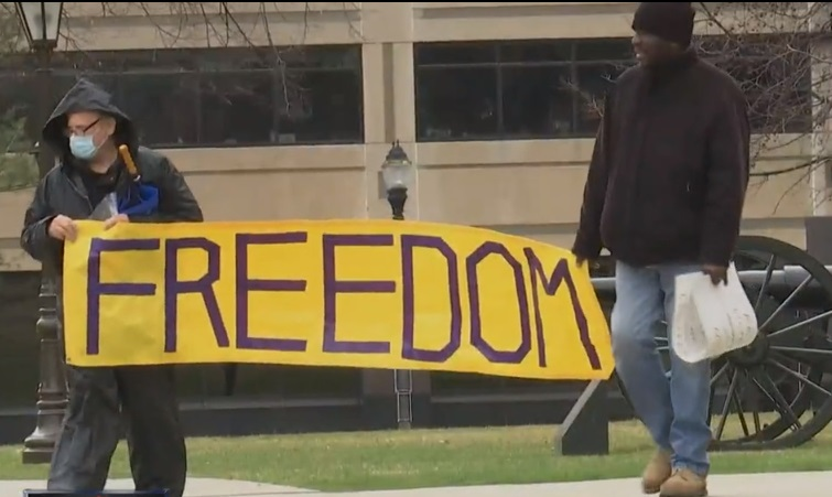 """LP Groups: Scotty Boman and Gregory Creswell escort """"Freedom"""" banner to the Capitol."""